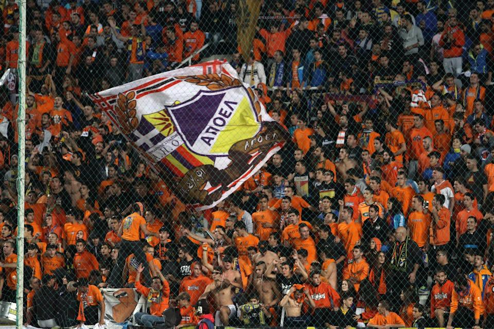 APOEL FC supporters cheer their team ahead of their Champions League group F match against Paris Saint-Germain at GSP Stadium in the Cypriot capital Nicosia on October 21, 2014 (AFP Photo/Yiannis Kourtoglou)