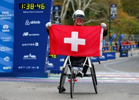 Marcel Hug of Switzerland celebrates at the finish line of the New York City Marathon after winning the wheelchair race in Central Park in New York, U.S., November 5, 2017. REUTERS/Brendan McDermid?