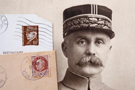 """Stamps and a portrait of French General Philippe Petain, published in the French newspaper ''L'Illustration"""" on August 4, 1917 (R), are seen in this picture illustration taken November 8, 2018.  REUTERS/Charles Platiau/Illustration"""