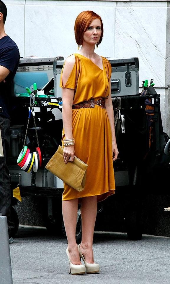 "Following in her footsteps was Cynthia Nixon (aka Miranda Hobbes), who looked chic and sleek in an asymmetrical apricot frock, faux croc belt, gold bangles, and nude platform heels. Jeffrey Ufberg/<a href=""http://www.wireimage.com"" target=""new"">WireImage.com</a> - September 8, 2009"