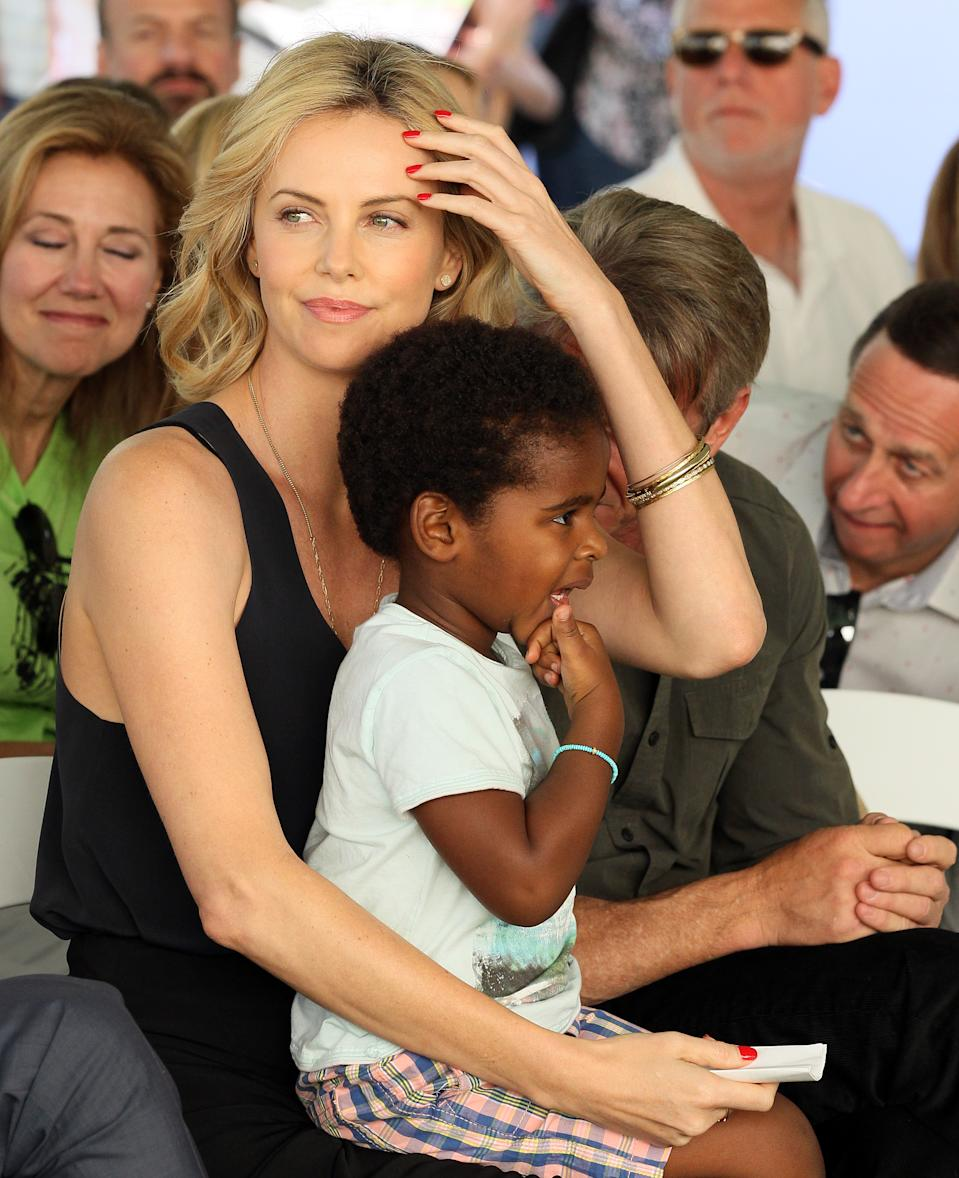 CENTURY CITY, CA - APRIL 18: Charlize Theron and Jackson Theron attend the generationOn West Coast Block Party on April 18, 2015 in Beverly Hills, California.  (Photo by JB Lacroix/WireImage)