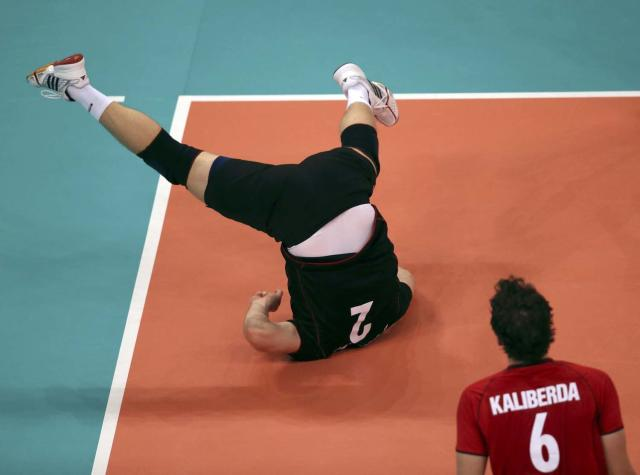 Germany's Markus Steuerwald falls during a play during their men's Group B volleyball match against the U.S. at the London 2012 Olympic Games at Earls Court July 31, 2012. REUTERS/Ivan Alvarado (BRITAIN - Tags: SPORT OLYMPICS SPORT VOLLEYBALL TPX IMAGES OF THE DAY)