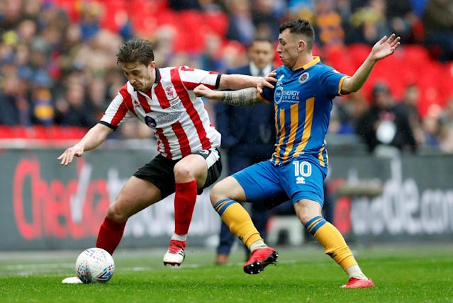 "Soccer Football - Checkatrade Trophy Final - Lincoln City vs Shrewsbury Town - Wembley Stadium, London, Britain - April 8, 2018 Shrewsbury Town's Nathan Thomas in action with Lincoln City's Alex Woodyard Action Images/Matthew Childs EDITORIAL USE ONLY. No use with unauthorized audio, video, data, fixture lists, club/league logos or ""live"" services. Online in-match use limited to 75 images, no video emulation. No use in betting, games or single club/league/player publications. Please contact your account representative for further details."