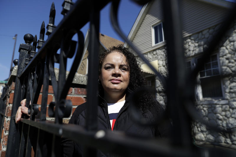 In this Thursday, May 7, 2020 photo, Nelis Rodriguez poses at her home in Chicago. Rodriguez has worked at the same restaurant for 21 years and in that time she never had to so much as think about getting another job. So, while she knew that much of the money she earns comes from tips and not the her $10-an-hour salary, she did not really appreciate what that meant until it was time to apply for unemployment. (AP Photo/Nam Y. Huh)