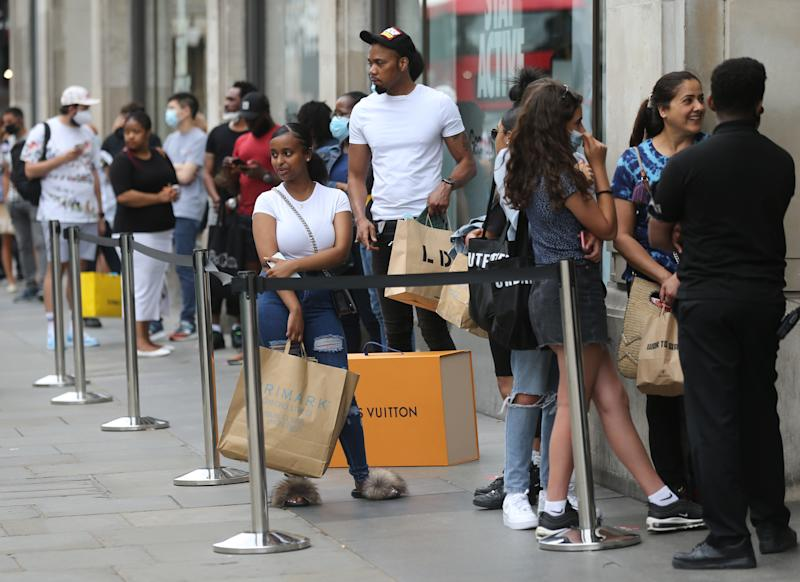 Shoppers queuing outside the Nike shop on Oxford Street, London, as non-essential shops in England open their doors to customers for the first time since coronavirus lockdown restrictions were imposed in March. Picture date: Monday June 15, 2020.