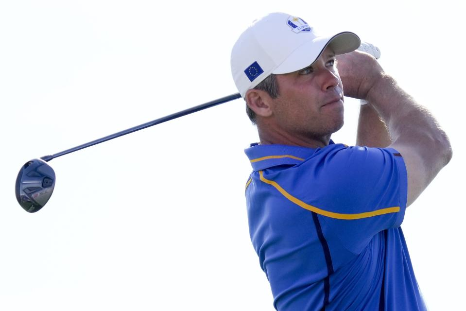 Team Europe's Paul Casey hits on the 11th hole during a four-ball match the Ryder Cup at the Whistling Straits Golf Course Friday, Sept. 24, 2021, in Sheboygan, Wis. (AP Photo/Ashley Landis)