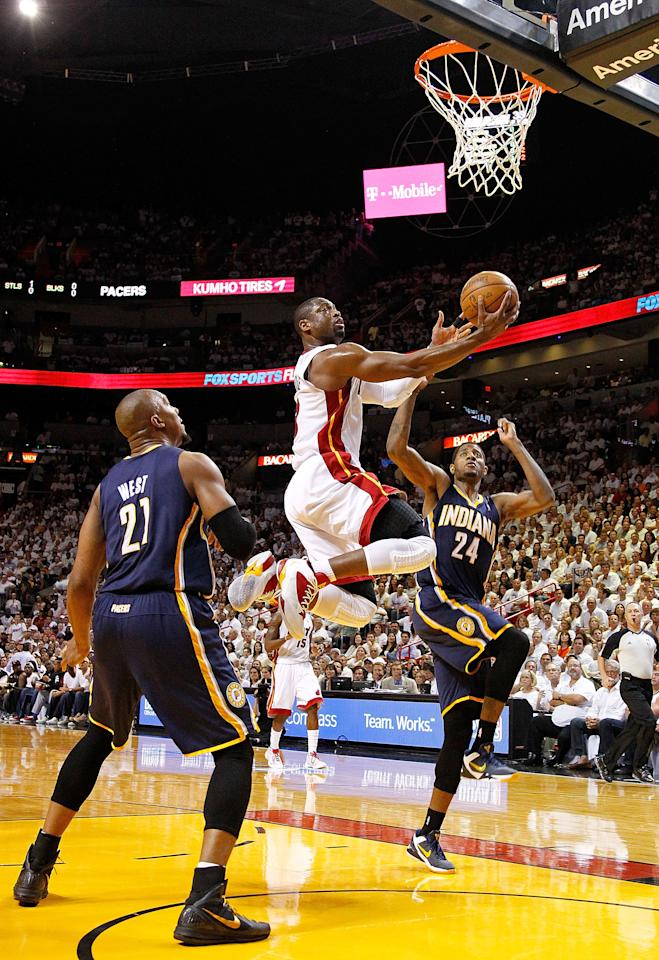 MIAMI, FL - MAY 22: Dwyane Wade #3 of the Miami Heat splits between David West #21 and Paul George #24 of the Indiana Pacers during Game Five of the Eastern Conference Semifinals in the 2012 NBA Playoffs  at AmericanAirlines Arena on May 22, 2012 in Miami, Florida. NOTE TO USER: User expressly acknowledges and agrees that, by downloading and/or using this Photograph, User is consenting to the terms and conditions of the Getty Images License Agreement.  (Photo by Mike Ehrmann/Getty Images)
