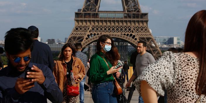 A woman wore a face mask in front of the Eiffel Tower in Paris on May 24.