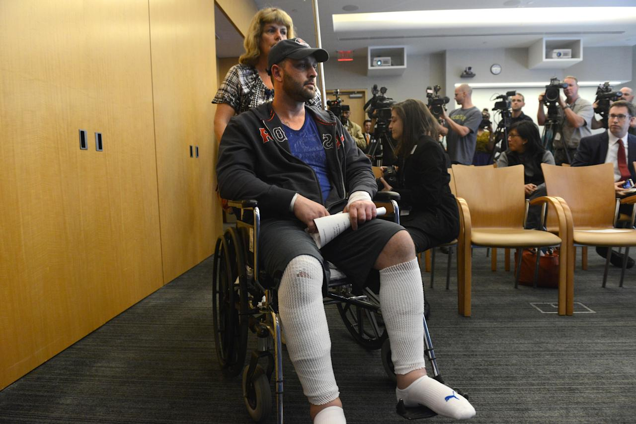 BOSTON - APRIL 30: Boston Marathon bombing victim Jarrod Clowery, of Stoneham, Massachusetts is wheeled into a press conference at Brigham and Women's Hospital April 30, 2013 in Boston, Massachusetts. Clowery was watching the marathon with a group of friends when the second bomb went off, burning his back, arms, and legs, and embedding shrapnel into his body that was later removed by physicians.   (Photo by Darren McCollester/Getty Images)