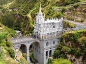 """Las Lajas Sanctuary in <a href=""""https://www.cntraveler.com/story/you-havent-seen-the-colombian-coast-without-time-in-providencia?mbid=synd_yahoo_rss"""" rel=""""nofollow noopener"""" target=""""_blank"""" data-ylk=""""slk:Colombia"""" class=""""link rapid-noclick-resp"""">Colombia</a> is one of the most unusual churches in the world, due to its precarious location 150 feet over a river gorge. The site first served as a shrine in the 1700s following a reported sighting of the Virgin Mary's image in the rocks, and the current Gothic-style church was built in the early 1900s."""