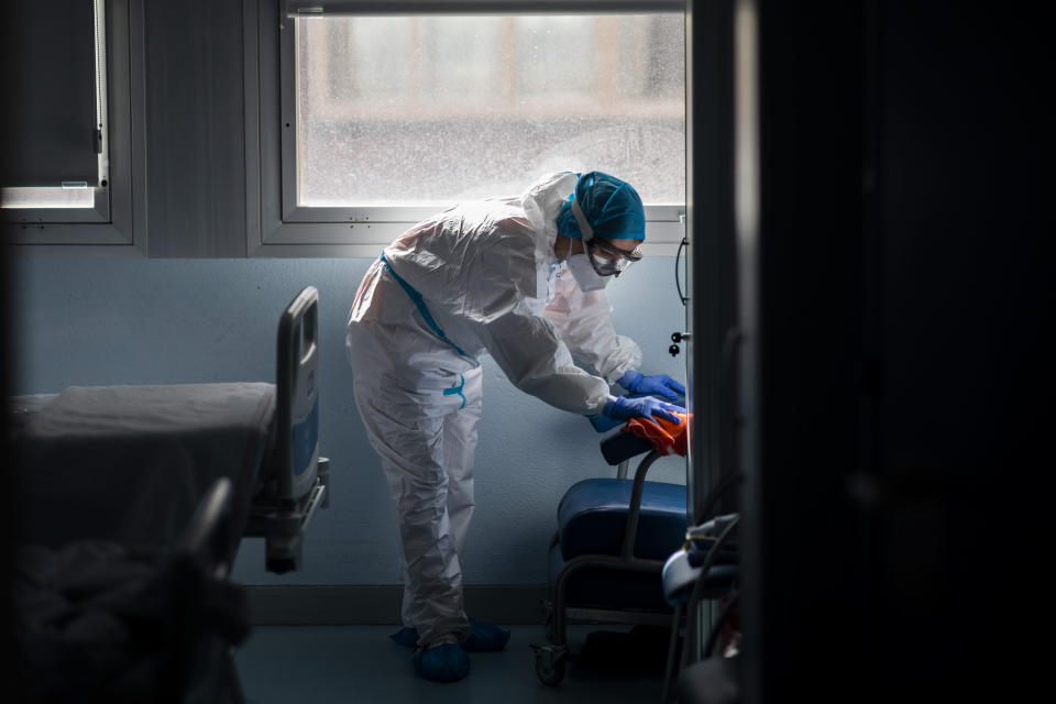 "A cleaning worker disinfects a room at the ""red zone,"" an area reserved for treating COVID-19, in the Severo Ochoa Hospital in Leganes on the outskirts of Madrid, Spain, Wednesday, Feb. 17, 2021. (AP Photo/Bernat Armangue)"