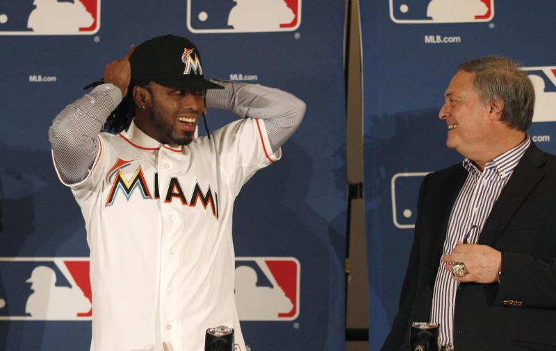 Miami Marlins  owner Jeffrey Loria, right, looks over to Jose Reyes during a news conference at the Major League Baseball 2011 Winter Meetings in Dallas,  Wednesday, Dec. 7, 2011.  The Marlins unveiled the newly signed free-agent shortstop Reyes. (AP Photo/LM Otero)