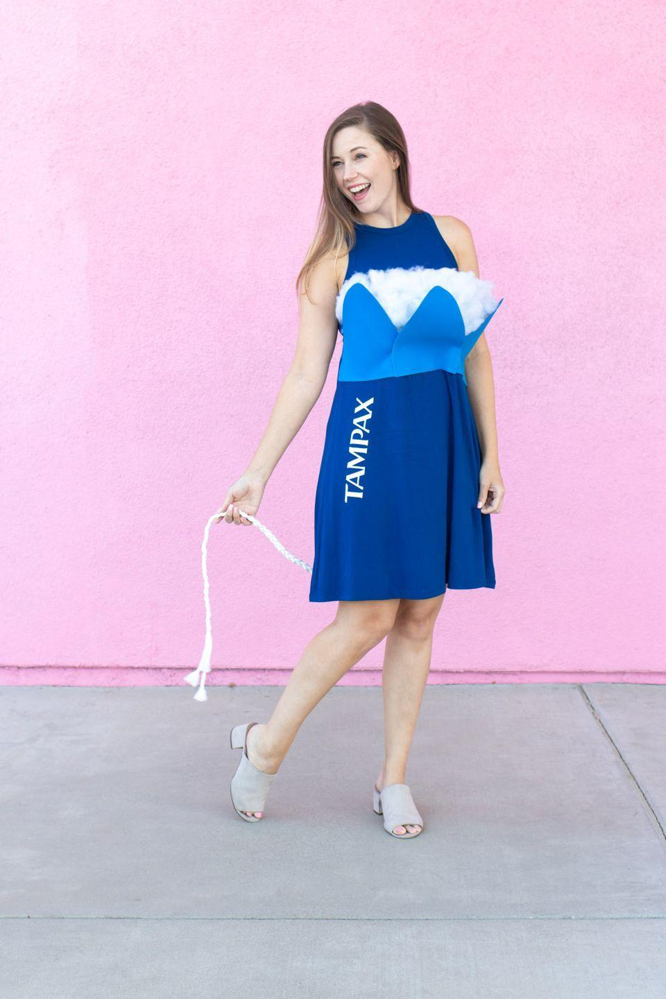 """<p>This bold choice is sure to be a conversation-starter.</p><p><strong>Get the tutorial at <a href=""""https://www.clubcrafted.com/tampon-costume-tampax/"""" rel=""""nofollow noopener"""" target=""""_blank"""" data-ylk=""""slk:Club Crafted"""" class=""""link rapid-noclick-resp"""">Club Crafted</a>.</strong></p><p><a class=""""link rapid-noclick-resp"""" href=""""https://www.amazon.com/Vintage-Flared-Sleeveless-line-CL698-6/dp/B07MQYJLDP/ref=sr_1_5?tag=syn-yahoo-20&ascsubtag=%5Bartid%7C10050.g.21600836%5Bsrc%7Cyahoo-us"""" rel=""""nofollow noopener"""" target=""""_blank"""" data-ylk=""""slk:Shop Blue Dresses"""">Shop Blue Dresses</a></p>"""