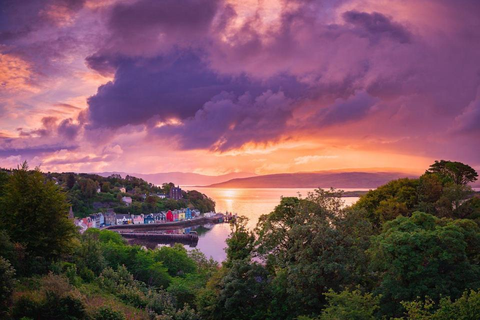 """<p>This view of Tobermory in the early mornings shows its colourful beauty.</p><p><a class=""""link rapid-noclick-resp"""" href=""""https://www.countrylivingholidays.com/tours/uk-scotland-west-coast-tradewind-cruise"""" rel=""""nofollow noopener"""" target=""""_blank"""" data-ylk=""""slk:SEE TOBERMORY AS YOU CRUISE SCOTLAND'S WEST COAST"""">SEE TOBERMORY AS YOU CRUISE SCOTLAND'S WEST COAST</a></p>"""