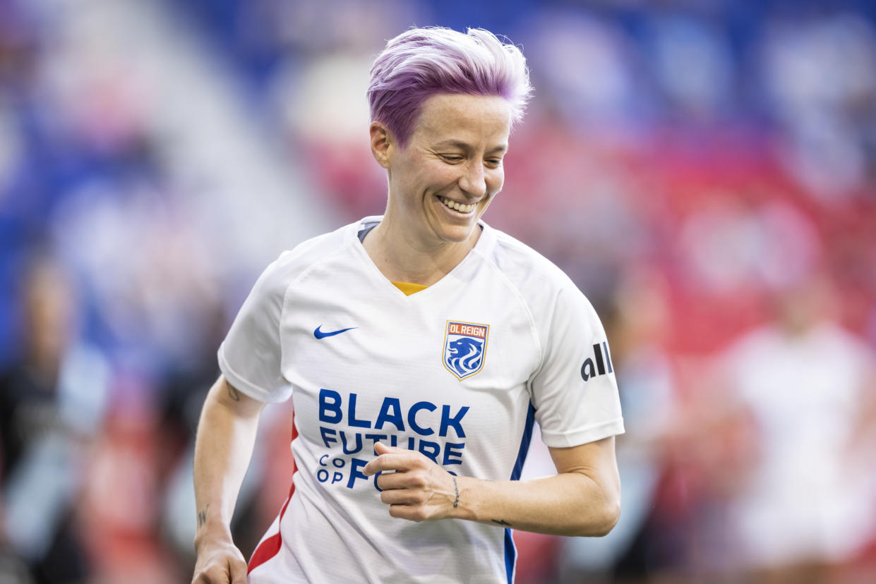 HARRISON, NJ - JUNE 05: Megan Rapinoe #15 of OL Reign is all smiles as she heads to take a corner kick in the first half of the match against NJ/NY Gotham FC at Red Bull Arena on June 5, 2021 in Harrison, New Jersey. (Photo by Ira L. Black - Corbis/Getty Images)