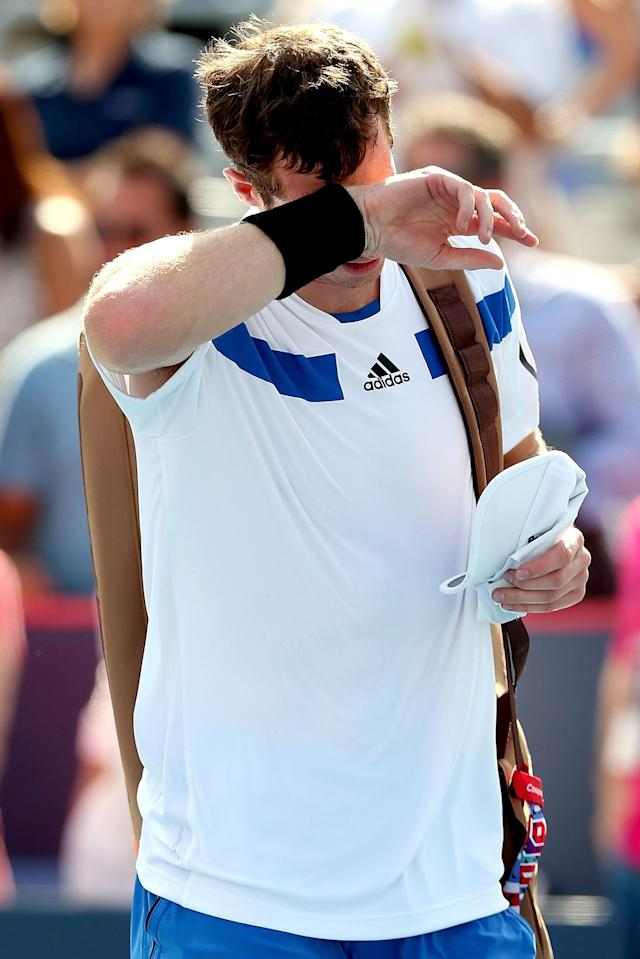 MONTREAL, QC - AUGUST 08: Andy Murray of Great Britain leaves the court after losing to Ernests Gulbis of Latvia during the Rogers Cup at Uniprix Stadium on August 8, 2013 in Montreal, Quebec, Canada. (Photo by Matthew Stockman/Getty Images)
