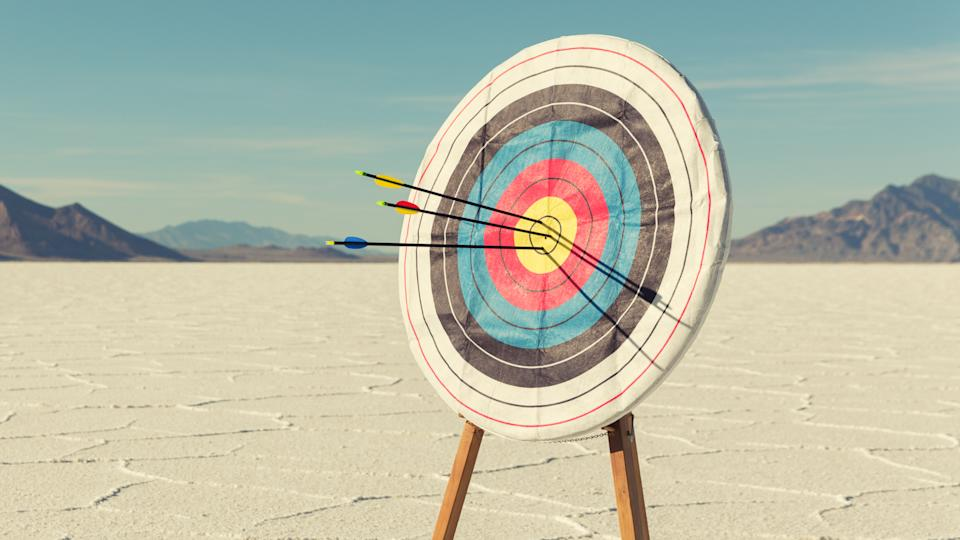 A target with several arrows in the bullseye stands on the Bonneville Salt Flats.
