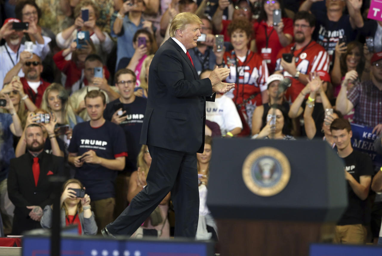 U.S. President Donald Trump arrives to speak at a campaign rally, Wednesday, June 20, 2018, in Duluth, Minn. (AP Photo/Jim Mone)
