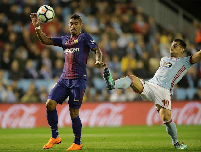Soccer Football - La Liga Santander - Celta Vigo vs FC Barcelona - Balaidos, Vigo, Spain - April 17, 2018 Barcelona's Paulinho in action with Celta Vigo's Jonny REUTERS/Miguel Vidal