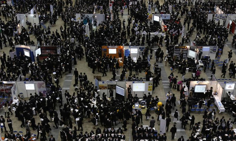 Job seekers attend a job fair held for fresh graduates in Tokyo in this December 7, 2013 file photo. REUTERS/Yuya Shino/Files