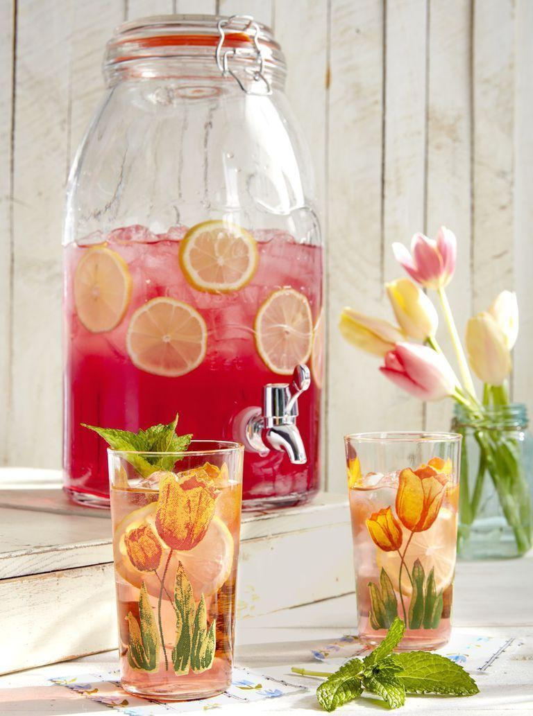 "<p>Serve this refreshing drink in adorable floral-adorned glasses.</p><p><strong><a href=""https://www.countryliving.com/food-drinks/a26799388/mint-tulip-cocktail-recipe/"" rel=""nofollow noopener"" target=""_blank"" data-ylk=""slk:Get the recipe"" class=""link rapid-noclick-resp"">Get the recipe</a>.</strong> </p>"
