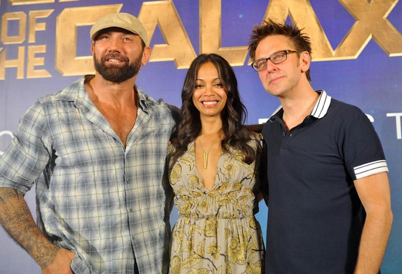 Marvel's Guardians of the Galaxy Director Dave Bautista (L) and cast members Zoe Saldana (C) and James Gunn pose during a photo call at Marina Bay Sands in Singapore on July 10, 2014 (AFP Photo/Mohd Fyrol)