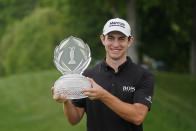 Patrick Cantlay holds the trophy after winning the Memorial golf tournament, Sunday, June 6, 2021, in Dublin, Ohio. (AP Photo/Darron Cummings)