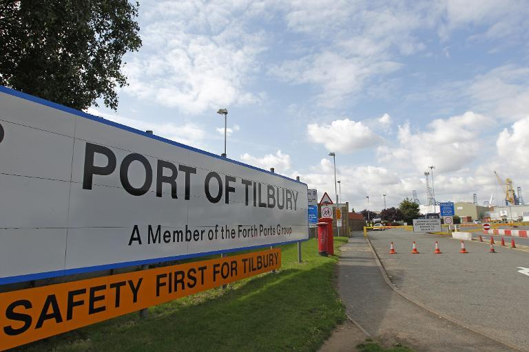 View of an entrance to Tilbury Docks, east of London on August 16, 2014, where one man was found dead and 19 people, including seven children, were taken to hospital after they were discovered inside a shipping container at the British port