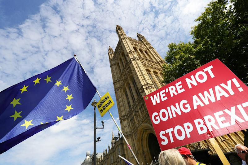 Anti-Brexit protesters outside the Houses of Parliament. Prime Minister Boris Johnson is seeking a suspension of Parliament ahead of a Queen's Speech on October 14. Suspending Parliament will reduce the time for opponents to schedule Parliamentary business before the Brexit deadline. (Photo by Aaron Chown/PA Images via Getty Images)