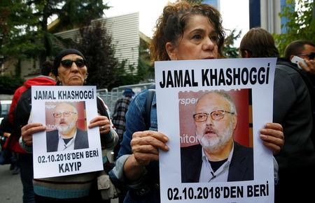 Human rights activists hold pictures of Saudi journalist Jamal Khashoggi during a protest outside the Saudi Consulate in Istanbul