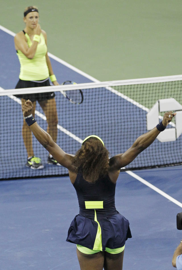 Serena Williams reacts after beating Victoria Azarenka, of Belarus, left, in the championship match at the 2012 US Open tennis tournament, Sunday, Sept. 9, 2012, in New York. Two points from defeat, Williams suddenly regained her composure to come back and win the last four games, beating No. 1-ranked Azarenka 6-2, 2-6, 7-5 on Sunday for her fourth U.S. Open title and 15th Grand Slam title overall. (AP Photo/Kathy Willens)