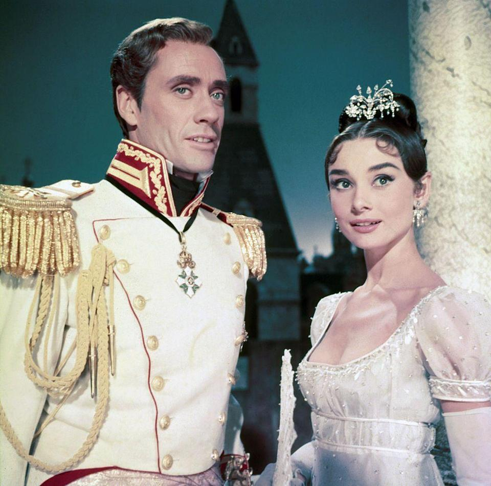<p>Audrey Hepburn's diamond chandelier tiara and earrings complimented her ornate hairstyle and Regency-era dress for the film, <em>War and Peace</em>. The actress costarred in the picture with her then-husband, Mel Ferrer. </p>