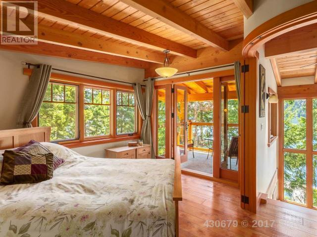 <p><span>3905 #407-3676 Horne Lake Caves Rd., Qualicum Beach, B.C.</span><br> There are three bedrooms, offering beautiful views of the surrounding forest.<br> (Photo: Zoocasa) </p>