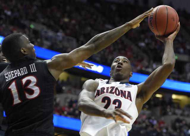 Arizona forward Rondae Hollis-Jefferson (23) shoots over San Diego State forward Winston Shepard (13) during the first half in a regional semifinal of the NCAA men's college basketball tournament, Thursday, March 27, 2014, in Anaheim, Calif. (AP Photo/Mark J. Terrill)