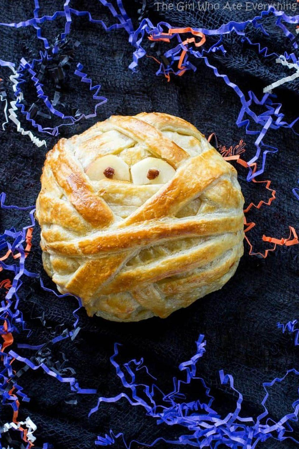 "<p>This spooky pastry face is packed with Brie cheese, brown sugar, and cinnamon pecans for a delicious <a href=""https://www.womansday.com/food-recipes/g2574/easy-halloween-appetizers/"" rel=""nofollow noopener"" target=""_blank"" data-ylk=""slk:Halloween appetizer"" class=""link rapid-noclick-resp"">Halloween appetizer</a>. </p><p><strong>Get the recipe at <a href=""http://www.the-girl-who-ate-everything.com/2016/10/mummy-brie.html"" rel=""nofollow noopener"" target=""_blank"" data-ylk=""slk:The Girl Who Ate Everything"" class=""link rapid-noclick-resp"">The Girl Who Ate Everything</a>. </strong></p>"