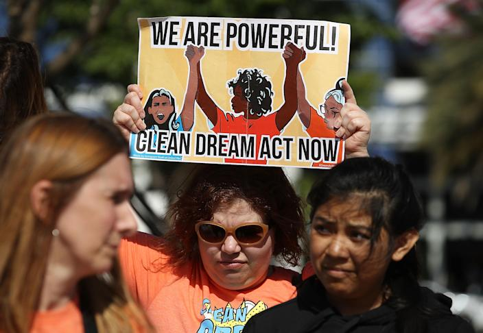 <p>Protesters gather in front of the offices of Sen. Marco Rubio (R-FL) to ask him to help recipients of the Deferred Action for Childhood Arrivals (DACA) on Jan. 22, 2018 in Doral, Fla. (Photo: Joe Raedle/Getty Images) </p>