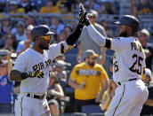 Pittsburgh Pirates' Starling Marte, left, is greeted by Gregory Polanco (25) after hitting a solo home run off Philadelphia Phillies starting pitcher Jake Arrieta in the third inning of a baseball game in Pittsburgh, Saturday, July 7, 2018. (AP Photo/Gene J. Puskar)