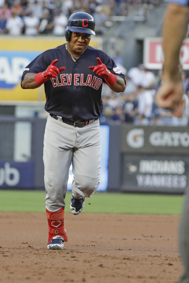 Cleveland Indians' Jose Ramirez gestures to teammates as he runs the bases after hitting a grand slam during the first inning of the team's baseball game against the New York Yankees on Thursday, Aug. 15, 2019, in New York. (AP Photo/Frank Franklin II)