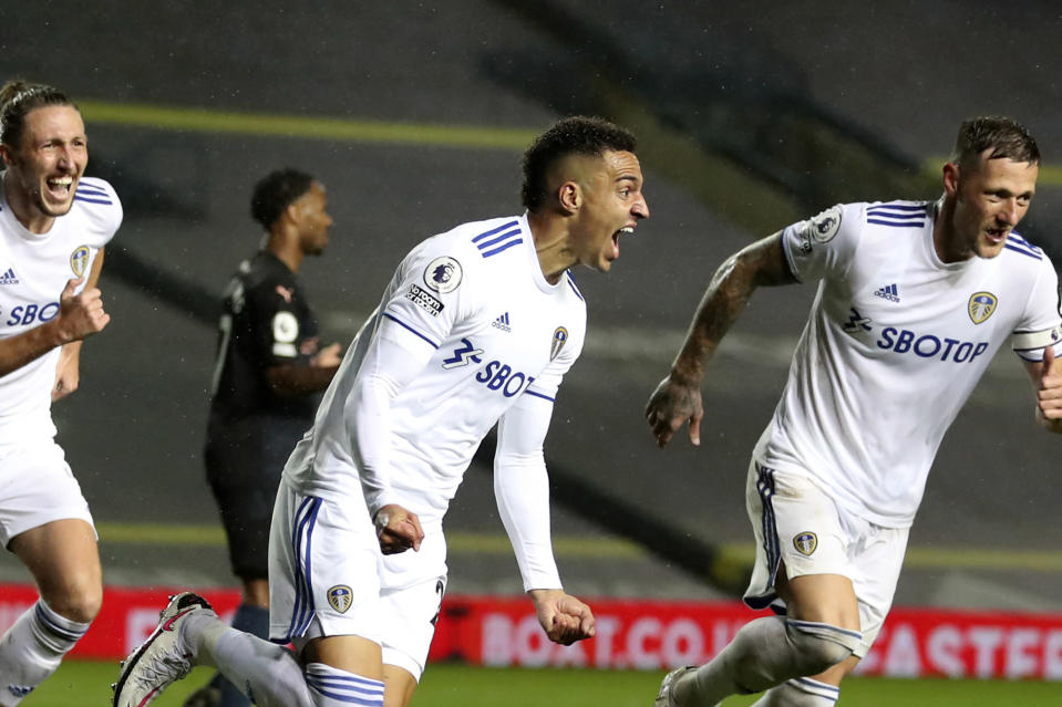 Leeds United's Rodrigo, center, celebrates after scoring his side's first goal during the English Premier League soccer match between Leeds United and Manchester City at Elland Road in Leeds, England, Saturday, Oct. 3, 2020. (Cath Ivill/Pool via AP)