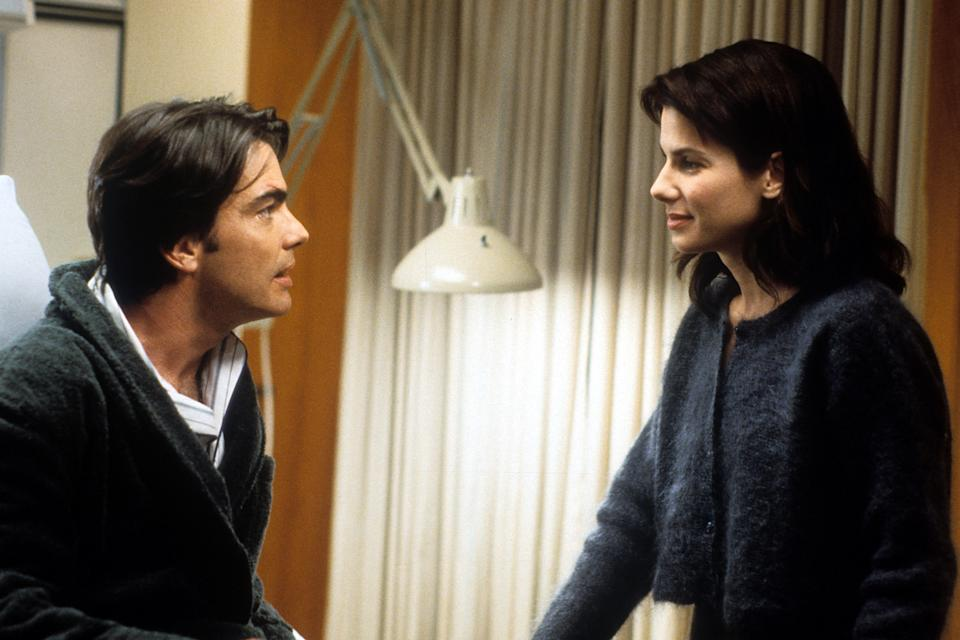 Peter Gallagher is visited by Sandra Bullock in a scene from the film 'While You Were Sleeping', 1995. (Photo by Buena Vista/Getty Images)