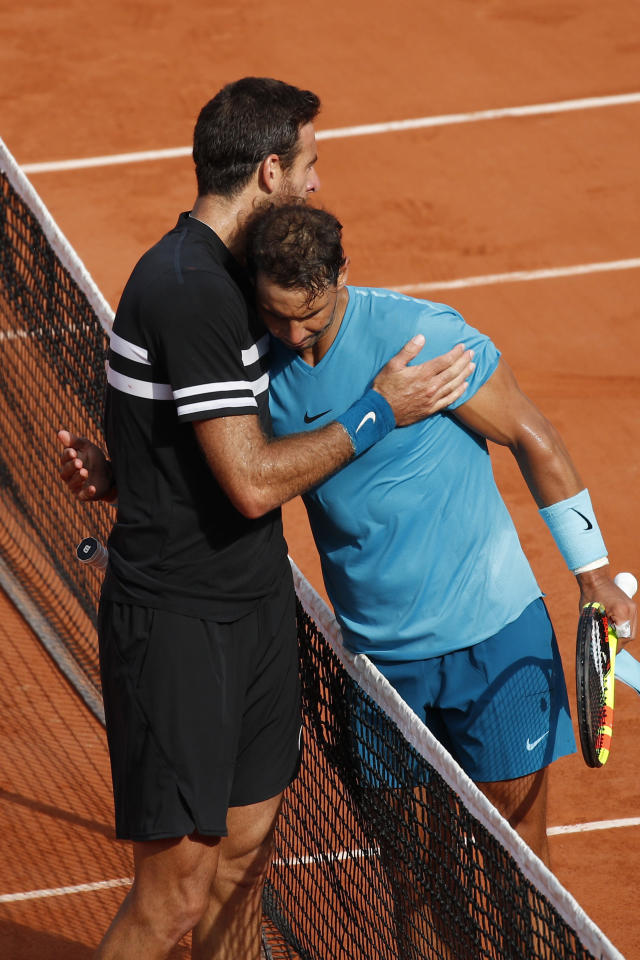 Spain's Rafael Nadal is congratulated by Argentina's Juan Martin del Potro, left, after Nadal won the semifinal match of the French Open tennis tournament in three sets 6-4, 6-1, 6-2, at the Roland Garros stadium in Paris, France, Friday, June 8, 2018. (AP Photo/Christophe Ena)