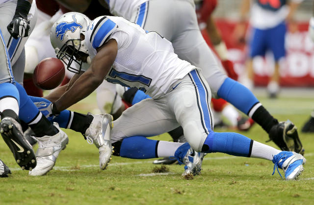 Detroit Lions running back Reggie Bush (21) fumbles against the Arizona Cardinals during the second half of a NFL football game, Sunday, Sept. 15, 2013, in Glendale, Ariz. (AP Photo/Matt York)