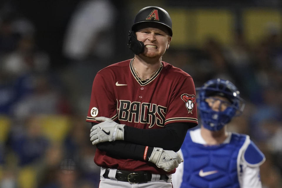 Arizona Diamondbacks' Pavin Smith reacts to being hit by a pitch from Los Angeles Dodgers relief pitcher Alex Vesia during the seventh inning of a baseball game Wednesday, Sept. 15, 2021, in Los Angeles. (AP Photo/Ashley Landis)