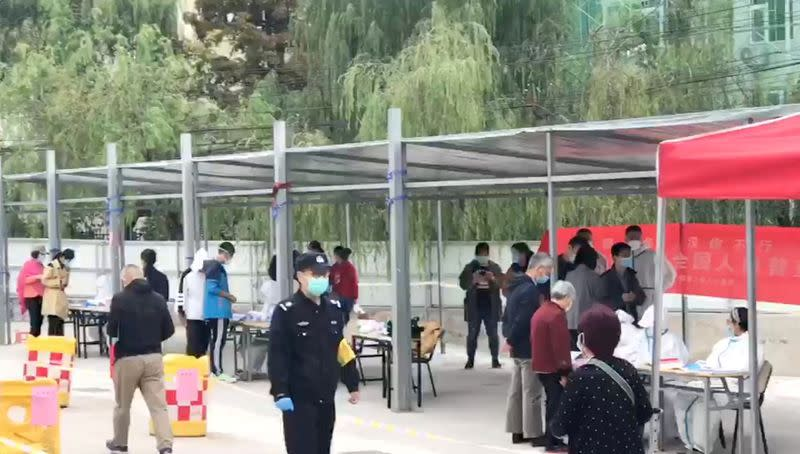 Social media video still of people queuing up to take a test for the coronavirus disease (COVID-19) in Qingdao