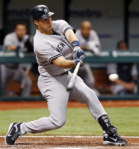 New York Yankees' Mark Teixeira hits a home run during the seventh inning of a baseball game against the Tampa Bay Rays, Wednesday, July 4, 2012, in St. Petersburg, Fla. (AP Photo/Mike Carlson)