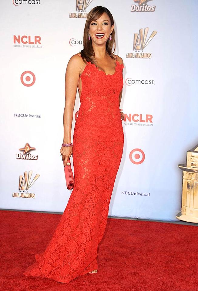 Eva La Rue certainly didn't blend into the red carpet thanks to the plunging floor-length lace dress she donned at the NCR ALMA Awards in Santa Monica, California, in September. (9/10/2011)