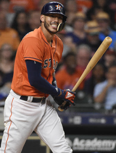 Houston Astros' Carlos Correa reacts after striking out during the fourth inning of the team's baseball game against the Kansas City Royals, Friday, June 22, 2018, in Houston. (AP Photo/Eric Christian Smith)