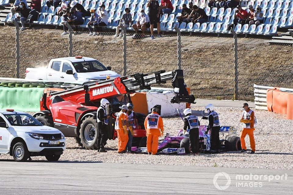 """Marshals remove the car of Lance Stroll, Racing Point RP20, after a collision with Max Verstappen, Red Bull Racing RB16, during FP2<span class=""""copyright"""">Mark Sutton / Motorsport Images</span>"""