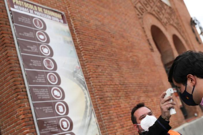 A man has his temperature checked before entering Las Ventas bullring ahead of the first bullfight since the start of the COVID-19 pandemic, in Madrid
