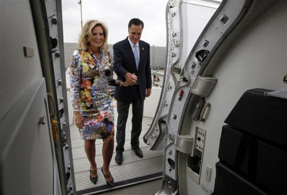 Mitt Romney steps aboard his chartered aircraft with his wife Ann in Tel Aviv, July 30, 2012.
